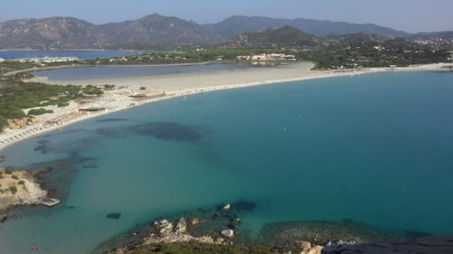 pan / elevated view of villasimius beach - spiaggia stock videos & royalty-free footage