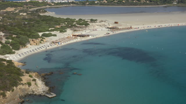 zo / elevated view of villasimius beach - spiaggia stock videos & royalty-free footage