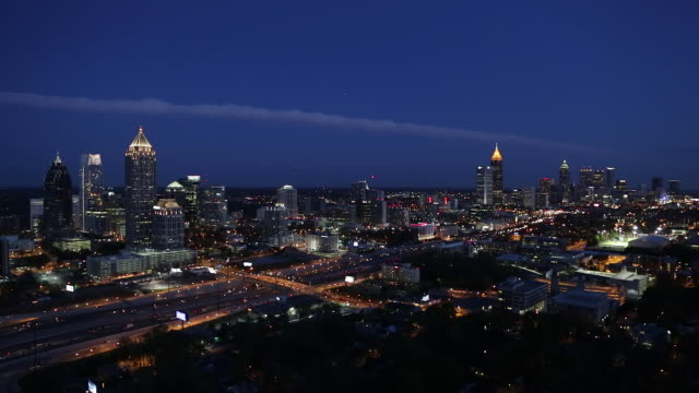 Elevated view over Interstate 85 passing the Midtown and Downtown Atlanta skyline, Georgia, United States of America