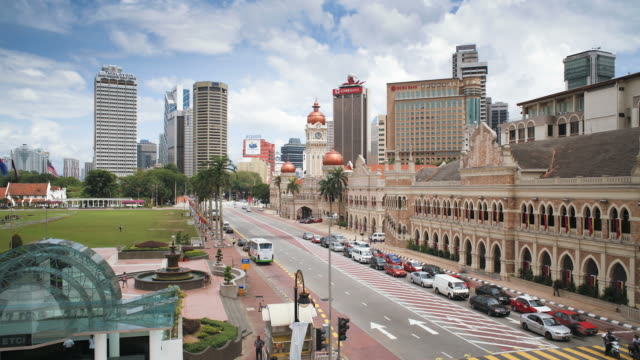 elevated view over merdaka square including the sultan abdul samad building, kuala lumpur, malaysia, asia - sultan abdul samad building stock videos & royalty-free footage