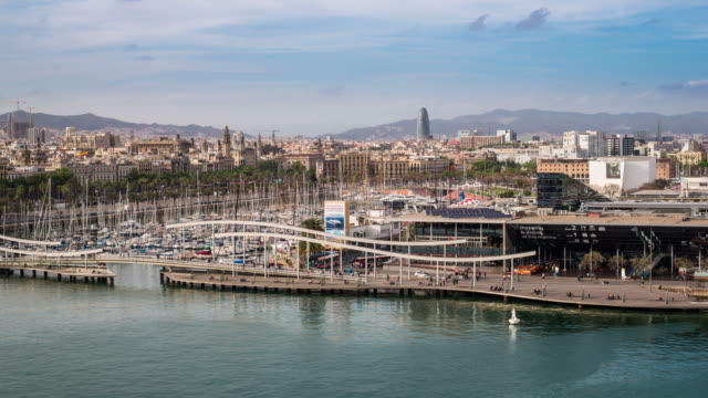 vídeos y material grabado en eventos de stock de elevated view over port vell - the old harbour district in barcelona, spain - time lapse - puerto de barcelona