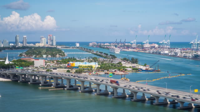 elevated view over the mac arthur causeway and the port of miami, the cruise capital of the world, miami, florida, usa - time lapse - macarthur causeway bridge stock videos and b-roll footage