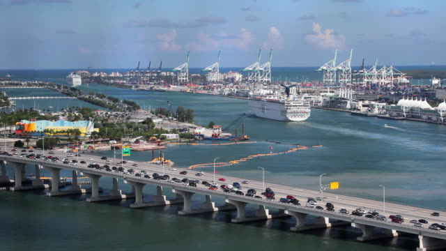 elevated view over the  mac arthur causeway and the port of miami, the cruise capital of the world, miami, florida, usa - macarthur causeway bridge stock videos and b-roll footage