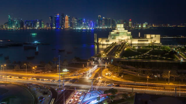 elevated view over the museum of islamic art and the dhow harbour to the modern skyscraper skyline, doha, qatar, middle east - ダウ船点の映像素材/bロール