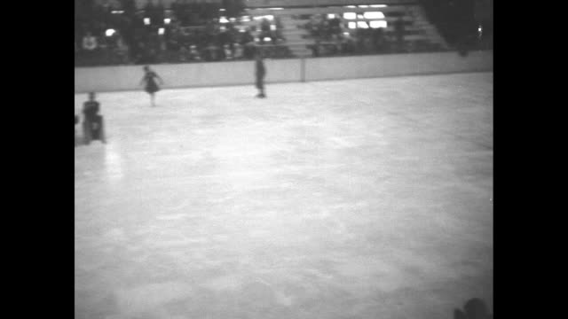 elevated view perry dring and his orchestra playing on figure skating rink, sonja henie skates into shot, camera follows her as she skates while band... - bass guitar stock videos & royalty-free footage