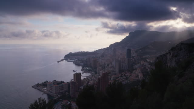 elevated view to monaco, monte carlo with sunbeams, time lapse. - monaco stock videos and b-roll footage