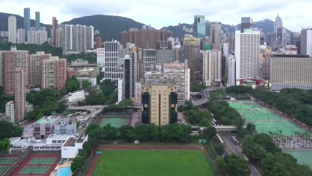 elevated view, victoria park and central district of hong kong island, hong kong, china - hong kong island stock videos & royalty-free footage