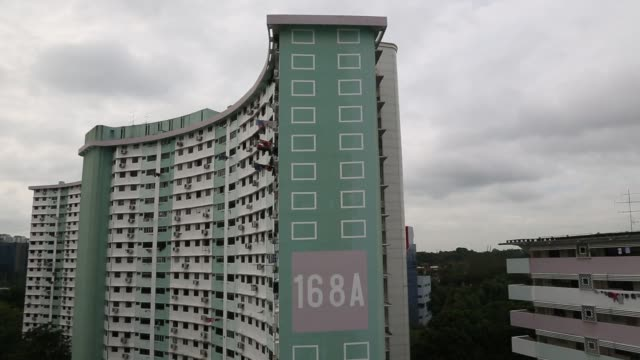 Elevated views residential blocks stand in Queenstown estate in Singapore on Monday Jan 15 Elevated views an SMRT Corp train moves along an elevated...