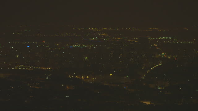 elevated wide sequence showing vast suburban areas ('banlieues') of paris in france at night. - population explosion stock videos & royalty-free footage
