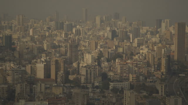 elevated wide shot of a hazy beirut in the early evening, lebanon. - population explosion stock videos & royalty-free footage