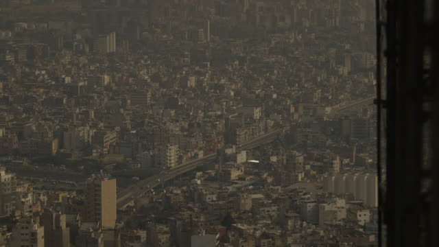 elevated wide shot of beirut's cityscape seen from a skyscraper under construction, lebanon. - population explosion stock videos & royalty-free footage