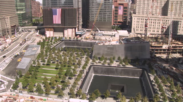 elevated wide shot showing the memorial plaza incorporating the national september 11 memorial and museum, summer 2011, manhattan, new york city, usa. - september 11 2001 attacks stock videos & royalty-free footage