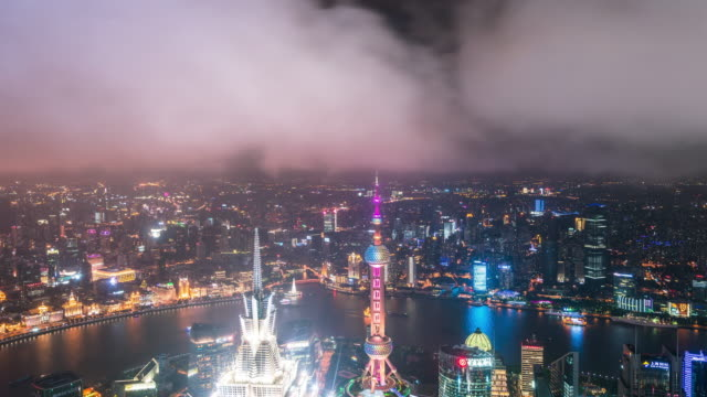 T/L WS ZO elevatet view of Shanghai city with dramatic cloudy sky
