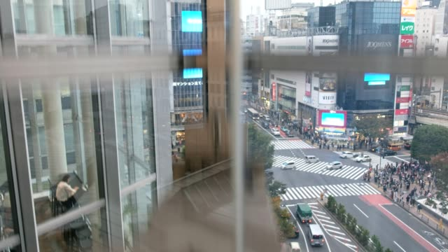 elevator capsule lift down with shibuya crossing - lift stock videos & royalty-free footage