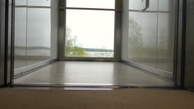 elevator doors (with a view) - open and close. - office doorway stock videos & royalty-free footage