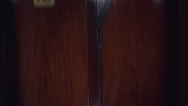 1966 pov elevator moving down from 14th floor to main floor - elevator point of view stock videos and b-roll footage
