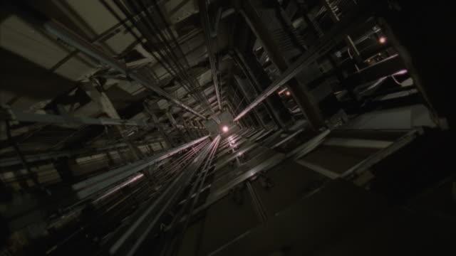 stockvideo's en b-roll-footage met ms elevator moving up in elevator shaft - kabel
