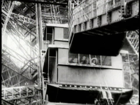 A elevator rises on the Eiffel Tower