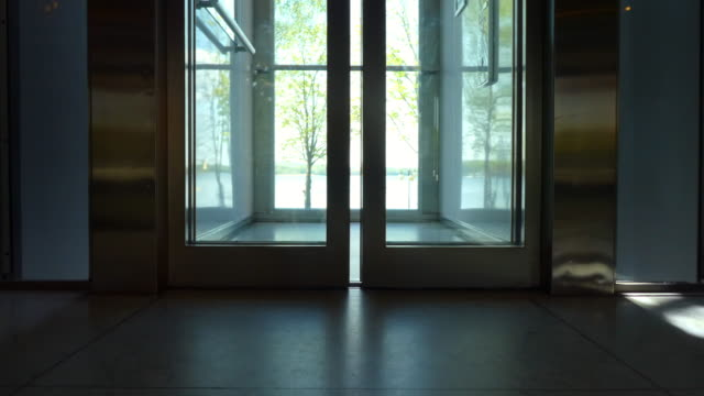 elevator with a view going up. elevator doors - open and close. - office doorway stock videos & royalty-free footage