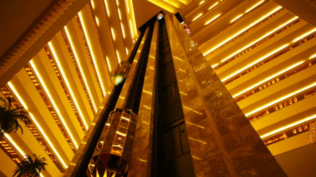 Elevators go up and down inside a luxury hotel in Doha, Qatar.