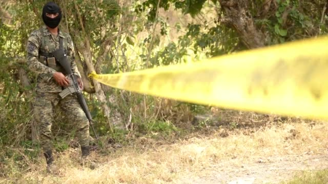 Eleven people were found slain in a town on the outskirts of San Salvador including eight workers at an electric plant police said on Thursday