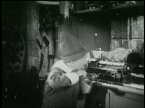 b/w 1925 elf working on toy train in santa's workshop - 1925 stock videos & royalty-free footage