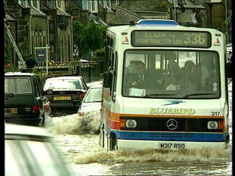 elgin and forres hit by severe flooding; itn scotland: elgin bus and other vehicles along flooded road train standing wheel-deep in floodwater next... - signal box stock videos & royalty-free footage