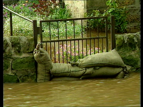 elgin and forres hit by severe flooding; itn scotland: elgin vehicles along flooded road train standing wheel-deep in floodwater next signal box man... - signal box stock videos & royalty-free footage