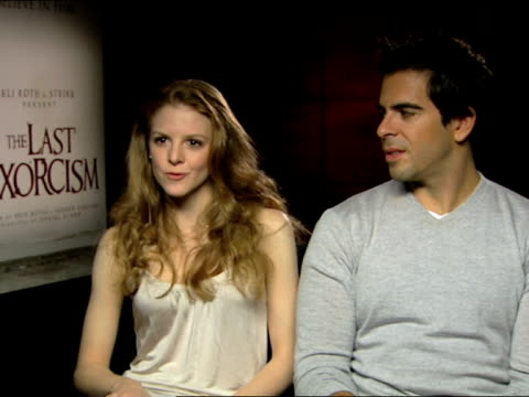 eli roth and ashley bell on previous characters, comedy at the the last exorcism - press junket at london england. - exorcism stock videos & royalty-free footage