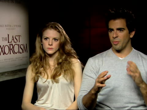eli roth and ashley bell on the film, paranormal activity, understanding where the 'scare's' lay at the the last exorcism - press junket at london... - exorcism stock videos & royalty-free footage