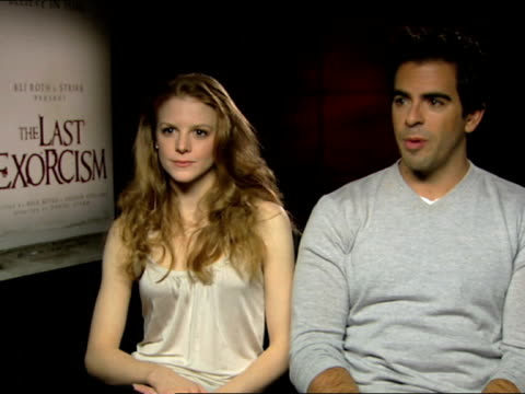 eli roth and ashley bell on the uk fans, the success of the movie at the the last exorcism - press junket at london england. - exorcism stock videos & royalty-free footage