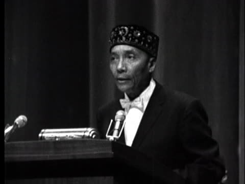 elijah muhammad leader of the nation of islam speaks to a gathering of black muslims in chicago as malcolm x listens in the background - 1962 stock videos & royalty-free footage