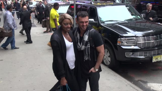 Eliminated DWTS couple NeNe Leakes Tony Dovolani exit the Good Morning America show poses for photographers with fans before leaving in Celebrity...
