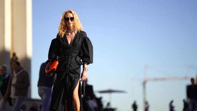 elina halimi wears a black dress outside rochas during paris fashion week womenswear spring/summer 2019 on september 26 2018 in paris france - vestito nero video stock e b–roll