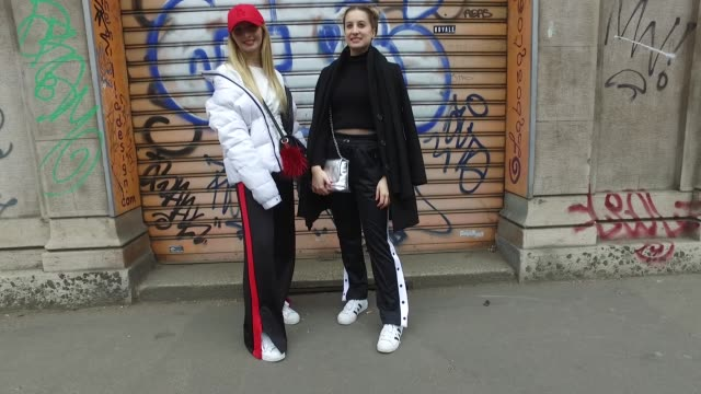 elisa comunian is wearing a pull & bear sweater, bershka trousers, adidas shoes, outsider jacket, new era cap and vintage bag and roberta marson is... - adidas stock videos & royalty-free footage