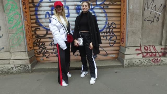 elisa comunian is wearing a pull & bear sweater, bershka trousers, adidas shoes, outsider jacket, new era cap and vintage bag and roberta marson is... - bershka designer label点の映像素材/bロール