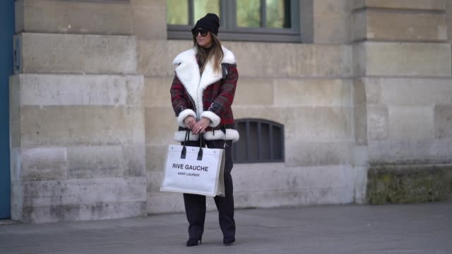 elisa taviti wears a black beanie hat a red checked pattern aviator jacket a rive gauche bag sunglasses suit pants during paris fashion week... - captain scarlet stock videos and b-roll footage