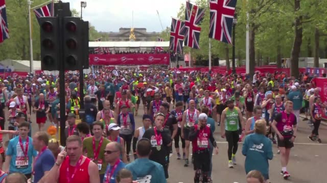eliude kipchoge and brigid kosgei win the 2019 london marathon as runners came from all over the world to run in the uk's capital - london marathon stock videos & royalty-free footage