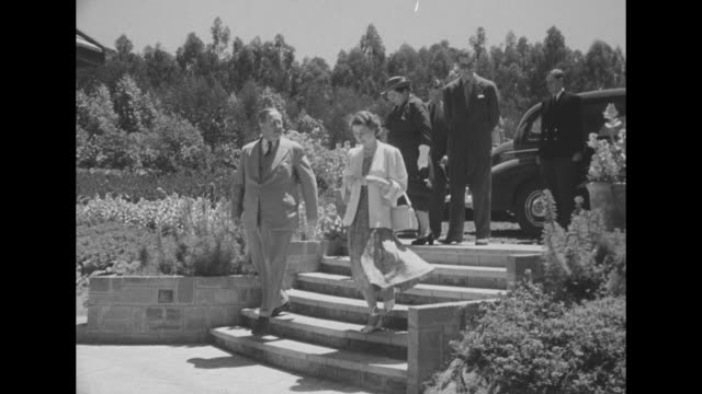 elizabeth and philip arrive by car at country house greeted with bows and curtsies by kenyan governor philip mitchell and his wife margery / they... - princess elizabeth stock videos and b-roll footage