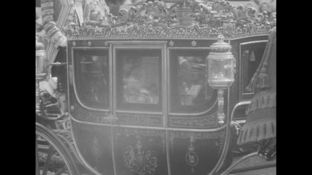elizabeth and philip in gold state coach / mounted horsemen with staffs and pennants / queen mother waves from irish state coach / carriage followed... - britisches königshaus stock-videos und b-roll-filmmaterial