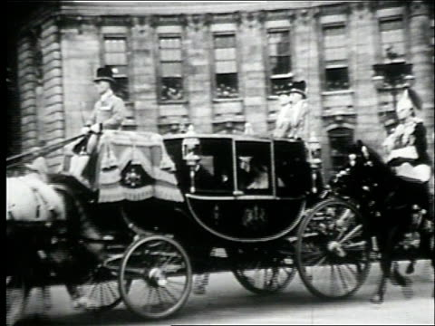 "elizabeth and the duke in the royal coach / the coach leaving the ""west door"" of westminster abbey / mass view of the crowd outside / the coach and... - anno 1947 video stock e b–roll"