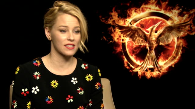 the hunger games mockingjay part 1 elizabeth banks interview england london int elizabeth banks interview sot on her character spending less time in... - effie stock videos and b-roll footage