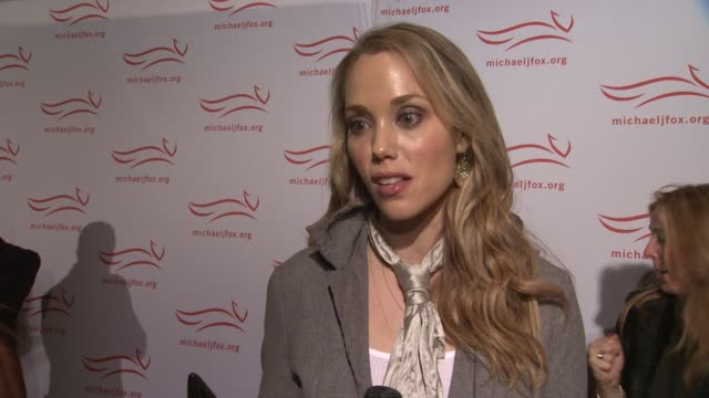 elizabeth berkley explains why michael j fox is truly a hero at the 2011 a funny thing happened on the way to cure parkinson's red carpet at new york... - michael j. fox stock videos and b-roll footage