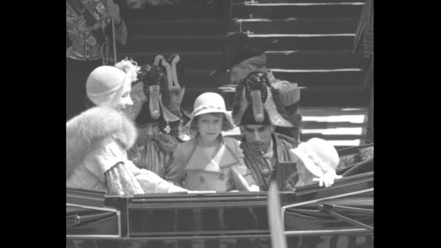 Elizabeth Duchess of York gets into coach at bottom of steps to entrance of St PaulÍs cathedral followed by daughters Princesses Margaret and...