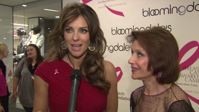 Elizabeth Hurley and Evelyn Lauder describe their respective lip design collections at the Bloomingdale's The Estee Lauder Companies Kick Off Breast...