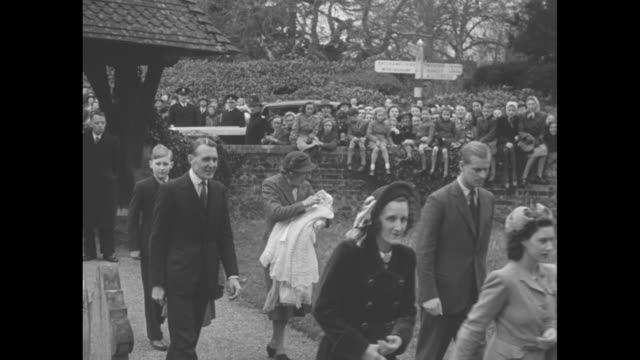 elizabeth ii prince philip princess margaret mrs john lycettwills and others are watched by villagers as they walk to the church for the christening... - 1948 stock videos & royalty-free footage