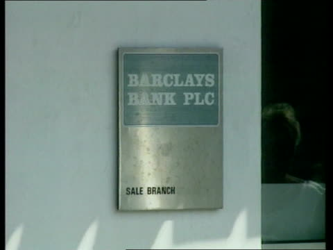Elizabeth Kerr freed GV Barclays Bank branch managed by husband of kidnap victim Elizabeth Kerr CMS Sign outside bank MS Road sign PAN RL street...