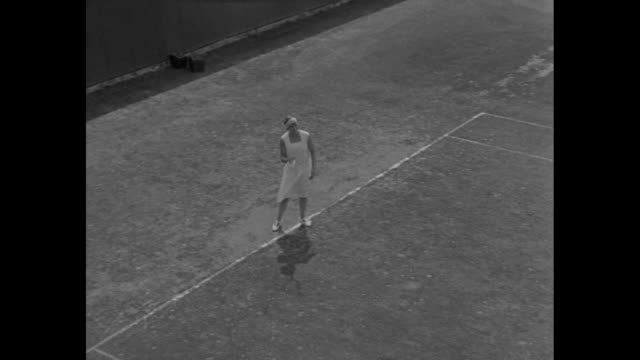 elizabeth nuthall holds tennis racket and balls / she smiles / vs she volleys ball / she serves / serve shown in slow-motion / vs from across net:... - forehand stock videos & royalty-free footage