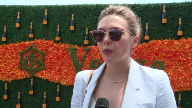 INTERVIEW Elizabeth Olsen on supporting the event at NinthAnnual Veuve Clicquot Polo Classicat Liberty State Park on June 4 2016 in Jersey City New...