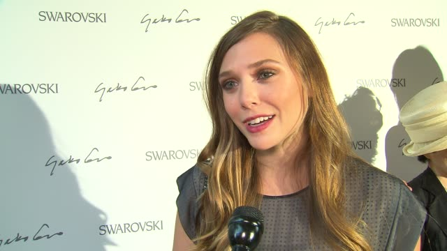 Elizabeth Olsen on wearing jewelry at Swarovski Celebrates The Launch Of Its Collaboration With Yoko Ono At The Swarovski Crystallized Concept Store...